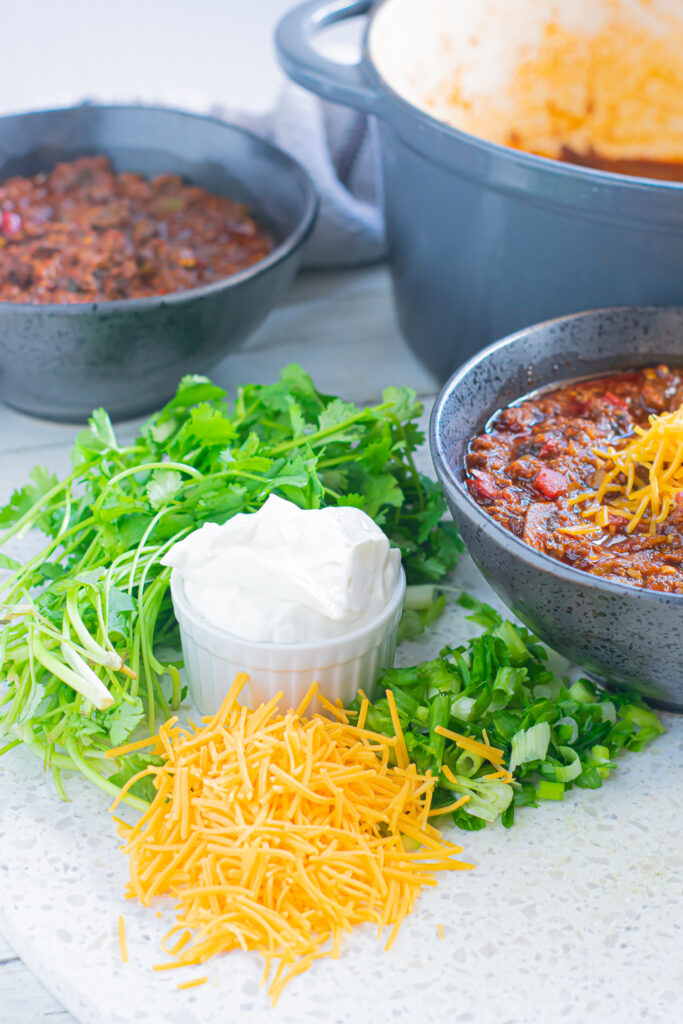 chili toppings on a cutting board