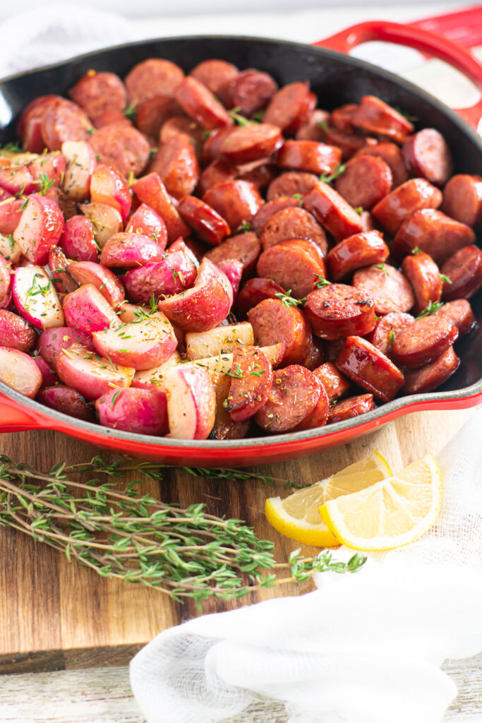 radish wedges and smoked sausage one pan meal tossed in lemon, garlic, butter, and herbs