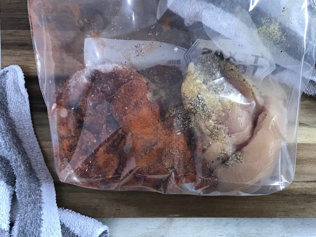 chicken and spices in a freezer bag