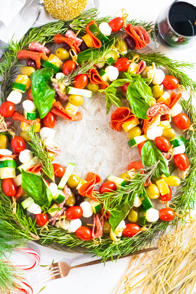 completed antipasto charcuterie wreath on a white background