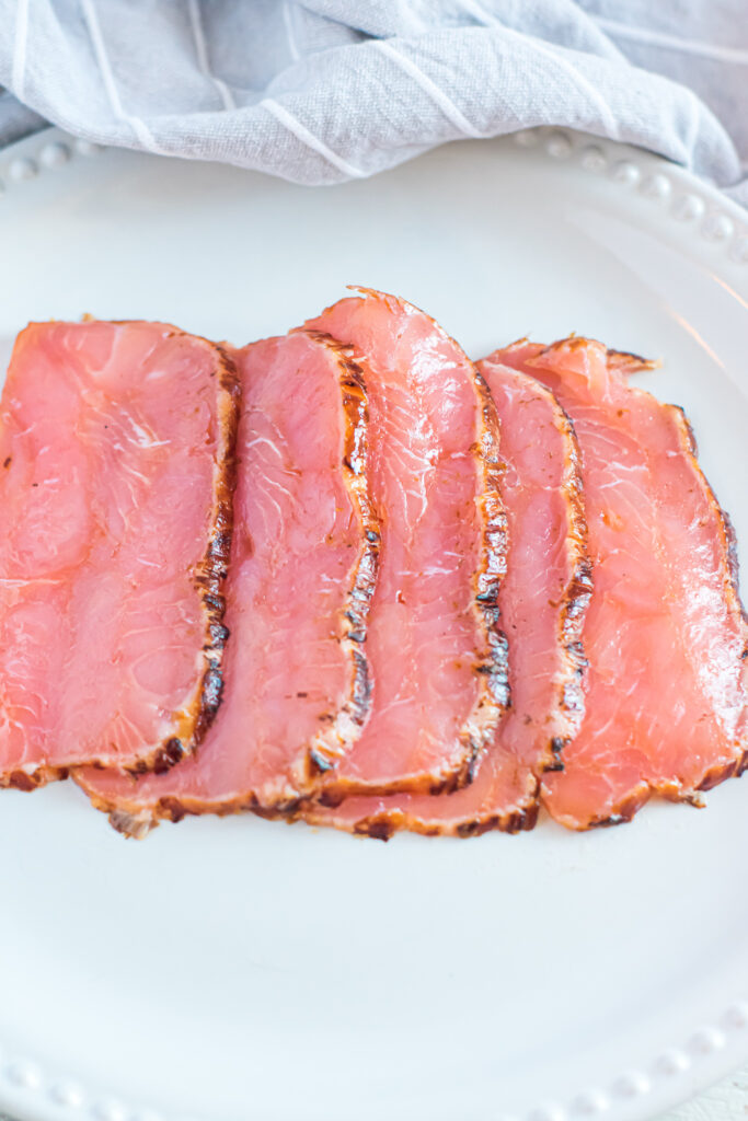 Smoked salmon on a white plate.
