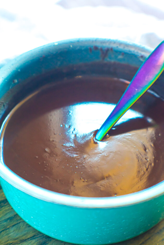 Melted chocolate in pan with spoon.
