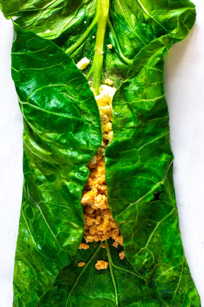 Ingredients placed inside of collard green wrap.