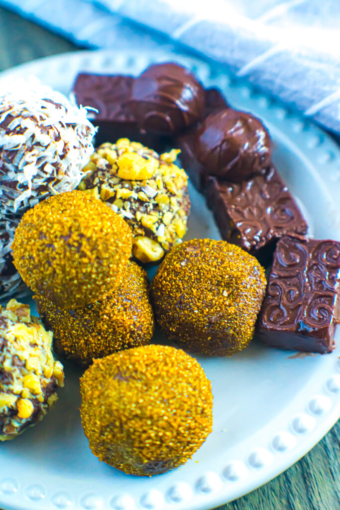 Chocolate truffles decorated on a white plate.