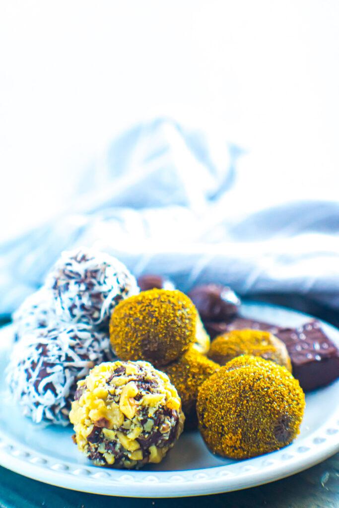 Chocolate truffles on white plate.