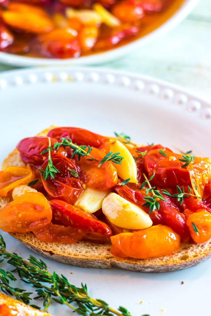 Cherry tomato confit on low-carb toast with garlic and thyme.