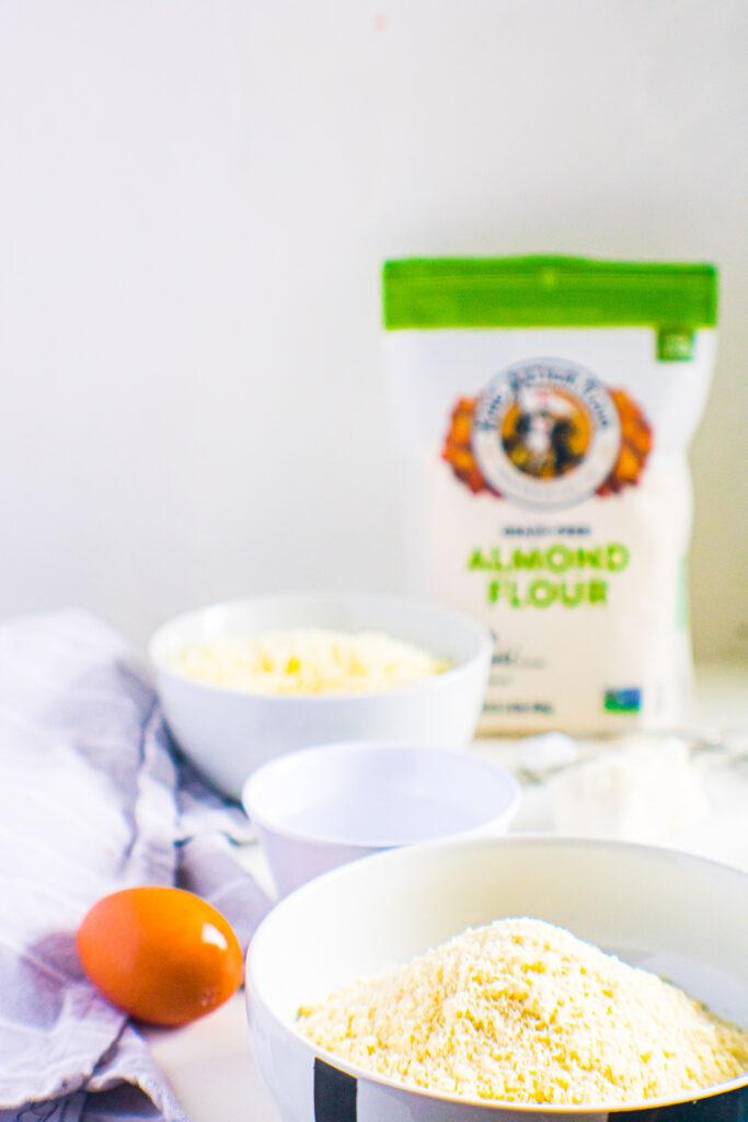egg, King Arthur almond flour, shredded cheese in white bowls