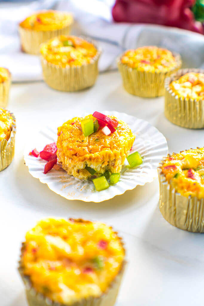 Denver omelet muffins topped with diced peppers.