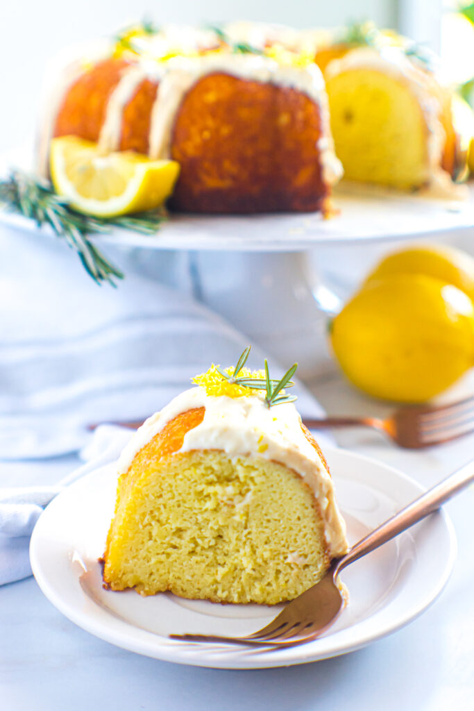 keto-friendly rosemary lemon pound cake sliced and plated with gold fork